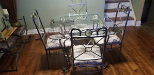 Wrought iron and glass dining room table with four chairs