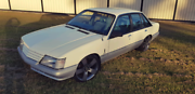 Holden VK Calais, 6 cylinder, white over silver blue trim, Park Ridge Logan Area Preview