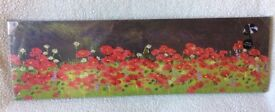 Canvas print of a field of poppies - new