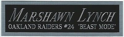 - MARSHAWN LYNCH RAIDERS NAMEPLATE AUTOGRAPHED SIGNED FOOTBALL HELMET JERSEY PHOTO