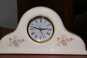 clocks,tv,candle holders,photo album,glassware,can opener