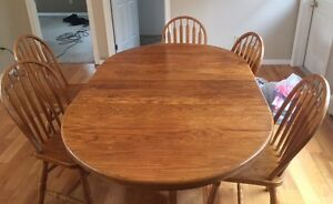 Solid Oak Pedestal table and 6 chairs