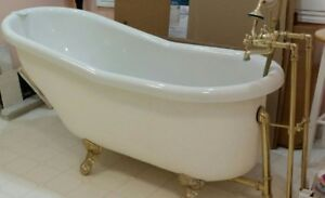 clawfoot acrylic tub with brass 3 piece standing faucet