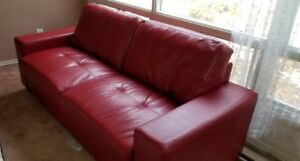 "Set of 2 matching red leather couches. 80"" x 33"". Easy to move."