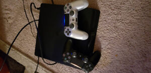Playstation 4 with 6 games 2 controllers