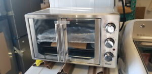 NEW OSTER OVEN ON SEAL