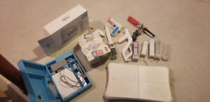 Wii console, controllers, games, fit board, accessories