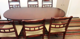 Mahogany extending dining room table and chairs
