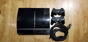 PS3 playstation 3 40GB PHAT with 2 controllers and a bunch of ga