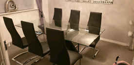 Barker and Stonehouse Glass Dining Table and Black Leather Chairs