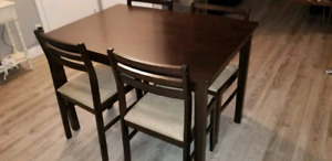 Wood dining room table with 4 chairs