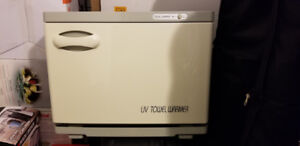 Hot towel warmer cabinet with UV sterilize feature