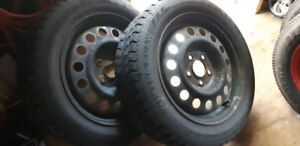 Four Studded Winterclaw 205/55R16 Tires on Rims