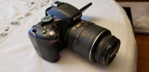 Nikon D5100 DSLR camera - with kit lens, tripod and accessories