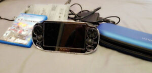 PS Vita + 64 GB Memory Card + Freedom Wars game + 2 travel cases