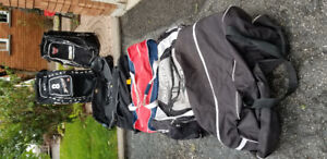 Many Hockey Bags & Goalie/Player Sticks/Equipment (pants new)