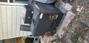 Free standing air tight wood stove for sale.