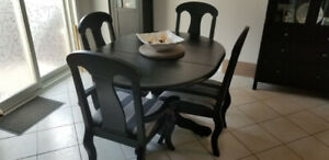 One black dining room table with 4 chairs for sale