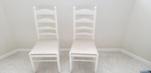 Two white , wood and wicker side chairs