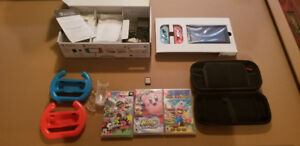 Nintendo Switch Gray Joycons + 4 GAMES and accessories
