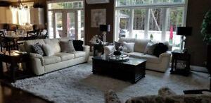 Two (2) Canadian made, matching, cream colored leather sofas