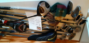 assorted golf clubs and sets