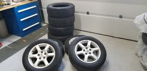 "16"" Nissan Rims and 2 Sets of Tires"
