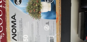 2 lighted potted Christmas topiary trees