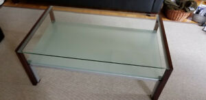 Glass top coffee table with Wood Supports and Metal frame