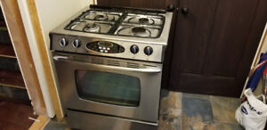 Gas range stove oven by maytag.