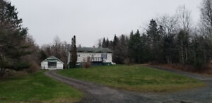 Stunning property in Sheet Harbour with large garage and view!