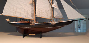 Bluenose sailing ship with great sails and rigging.  With book.