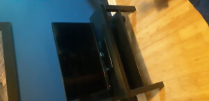 Tv with no remote asking 35 dollars with tv stand