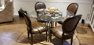 Round glass topped table and 4 chairs.  Asking $500 OBO.