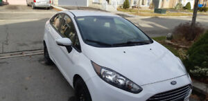 2015 Ford Fiesta White in perfect condition for sale.
