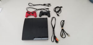 Play Station 3 (PS3) + 2 Joysticks + 2 Games