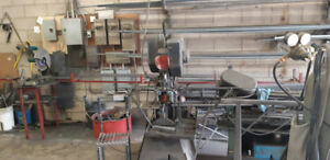 Metal shop with heavy duty equipment for sale