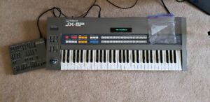 Roland JX-8P keyboard synthesizer and PG-800 programmer