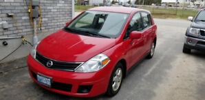 2012 Red, Nissan Versa 4-cylinder automatic with Xtronic CVT