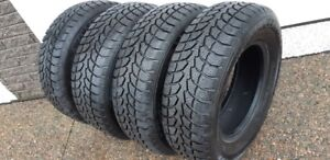 235/70R/16 WINTER CLAW EXTREME GRIP WINTER TIRES-LIKE NEW