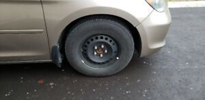235/65R16 GoodYear UltraGrip Snow tires (2007 Honda  Odyssey)