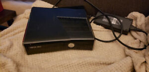 Xbox 360 console with games