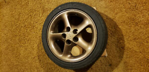 """16"""" Ford Probe GT rims and tires"""