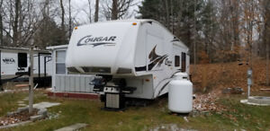 2008 Cougar 5th wheel RV with sunroom, deck and shed