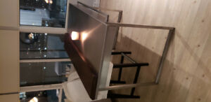 Stainless steel kitchen island with stained wood overlay!