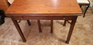 Antique Dinning table and hall table think it is Walnut