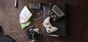 Xbox 360 with RockBand Instruments and 8 games.