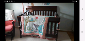 Graco crib and matching changetable, ottoman and glider.