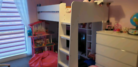 A white bunk bed with a mattress