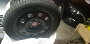 17inch snow tires and rims Used one season lots of tread left.
